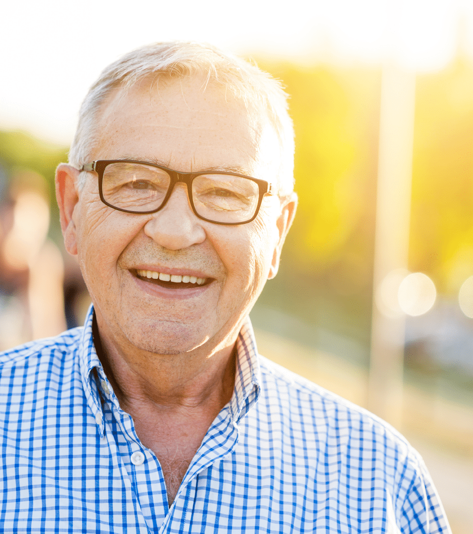 senior-aged man smiling in sun