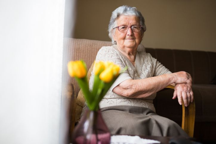 Older woman smiling and enjoying her living space